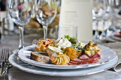 Appetizer plate. Closeup of an assortment of tasty appetizers at an elegant restaurant Royalty Free Stock Photo