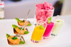 Appetizer plate of sauteed asparagus wrapped in thin slices smoked salmon Stock Image