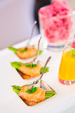 Appetizer plate of sauteed asparagus wrapped in thin slices smoked salmon Stock Photography