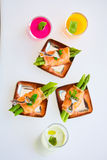Appetizer plate of sauteed asparagus wrapped in thin slices smoked salmon Royalty Free Stock Image