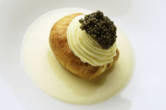 Appetizer Potato in Pastry Butter white Sparkling Wine Mousse an. Appetizer potato covered with puff pastry, white Sparkling Wine Mousse and Caviar Royalty Free Stock Image
