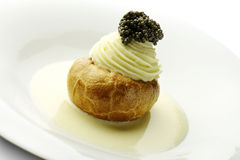 Appetizer Potato in Pastry Butter white Sparkling Wine Mousse an. Appetizer potato covered with puff pastry, white Sparkling Wine Mousse and Caviar Royalty Free Stock Photos