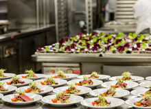 Appetizer Prep in Commercial Kitchen stock images