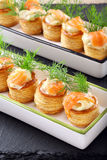 Appetizer puff pastry with dill dip and salmon Stock Image