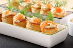 Appetizer puff pastry with dill dip and salmon Stock Photos