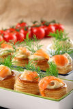 Appetizer puff pastry with dill dip and salmon Royalty Free Stock Image