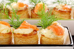 Appetizer puff pastry with dill dip and salmon Royalty Free Stock Photos