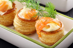 Appetizer puff pastry with dill dip and salmon Stock Photo