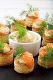Appetizer puff pastry with dill dip and salmon on stone tray Stock Image