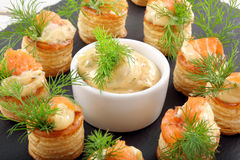 Appetizer puff pastry with dill dip and salmon on stone tray Stock Images