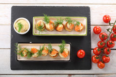 Appetizer puff pastry with dill dip and salmon on stone tray Royalty Free Stock Photography