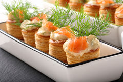Appetizer puff pastry with dill dip and salmon on stone tray Royalty Free Stock Photos