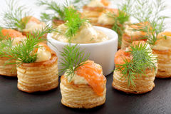 Appetizer puff pastry with dill dip and salmon on stone tray Stock Photography