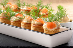Appetizer puff pastry with dill dip and salmon on stone tray Stock Photos