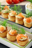 Appetizer puff pastry with dill dip and salmon on stone tray Royalty Free Stock Photo