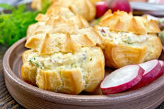 Appetizer of radish and cheese in profiteroles on plate with dil Royalty Free Stock Image