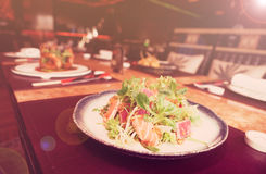 Appetizer with rare fried tuna and salmon, toned Royalty Free Stock Photo