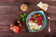 Appetizer with red bean, walnut, butter, coriander, parsley, chips on plate on wooden background. Healthy food. Top view royalty free stock photos