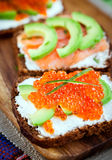Appetizer with red caviar, avocado, salmon and creamcheese Royalty Free Stock Photo