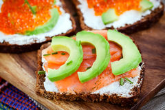 Appetizer with red caviar, avocado, salmon and creamcheese Royalty Free Stock Images