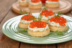 Appetizer with red caviar Stock Photos