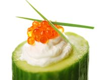Appetizer with red caviar and a cucumber Stock Photos