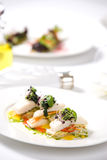 Appetizer of roasted fish and vegetables Royalty Free Stock Photos