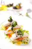 Appetizer of roasted fish and vegetables Stock Image