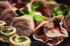 Appetizer rolls with meat bacon Stock Image