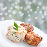 Appetizer - Russian salad and muffins Royalty Free Stock Photos