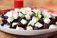 Appetizer salad of beets and goat cheese Stock Images