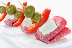 Appetizer with salami Stock Photos