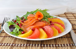 Appetizer with salmon. Appetizer of salmon with orange and grapefruit and a mixture of lettuce Royalty Free Stock Photos