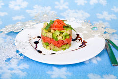 Appetizer of salmon and avocado and Christmas decor Royalty Free Stock Images