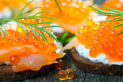 Appetizer with salmon and caviar Stock Photo