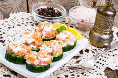 Appetizer with salmon, cucumber and goat cheese Royalty Free Stock Images