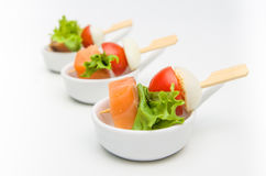 Appetizer of salmon, tomatoes and eggs with lettuce leaf Stock Photos
