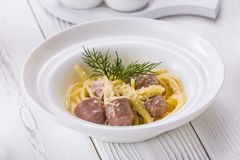 An appetizer sausage with cheese in a bowl royalty free stock images