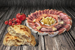Appetizer Savory Dish With Bunch Of Tomatoes And Leavened Pitta Flatbread Torn Loaf Set On Old Cracked Wood Backdrop. Plateful of traditional, gourmet, delicious Stock Image