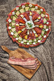Appetizer Savory Dish Meze with Bacon Rashers on Old Wood Background Royalty Free Stock Photos