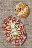 Appetizer Savory Dish Meze And Torn Flatbread Loaf Set On Bleached Jute Canvas Backdrop Stock Photo