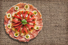 Appetizer Savory Dish Set On Coarse Grunge Burlap Backdrop Royalty Free Stock Photography