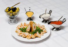 Appetizer served. Up with different dressings Stock Image