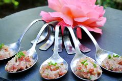 Appetizer served in spoons. The appetizer served in spoons stock image