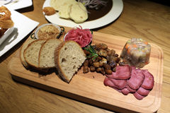 Appetizer served on wood plank Stock Images
