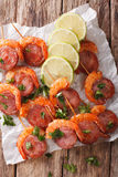 Appetizer of shrimp and chorizo on skewers and lime close up. ve Stock Photos