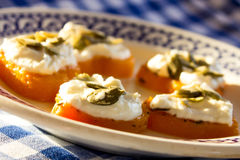Appetizer of shrimp and cream cheese on pumpkin hearts. Stock Image