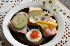 Appetizer. With shrimps,caviar,egg,ham and cheese Stock Photo