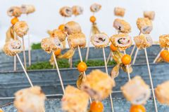 Appetizer skewer with meat and fruits stock images