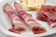 Appetizer of sliced ham and cheese Royalty Free Stock Photos
